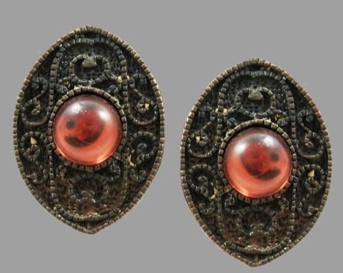 Eye shaped coppertone textured metal faux pearl clip on earrings