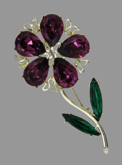 Flower brooch pin. Amethyst and green glass cabochons, rhinestone, gold tone jewelry alloy