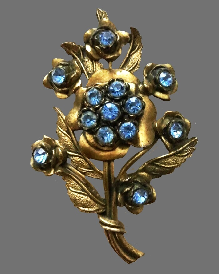 Flower brooch. Gold tone metal, blue rhinestones