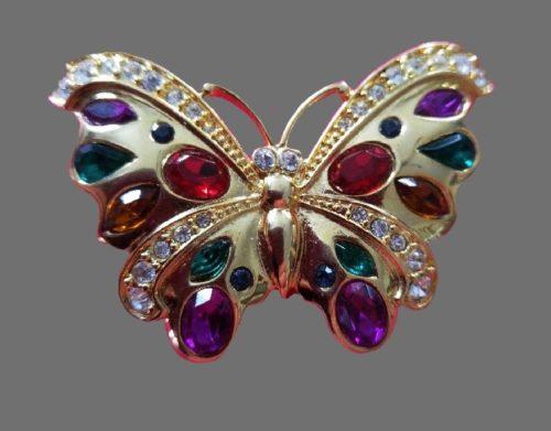 Gold tone butterfly brooch, color rhinestones