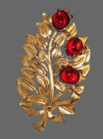 Gold tone flower tied with bow brooch, red cabochons