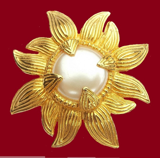 Carol Dauplaise vintage costume jewelry. Gorgeous sunflower brooch of gold tone with pearl in the middle