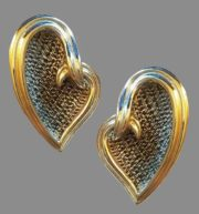 Heart shaped silver and gold tone earrings