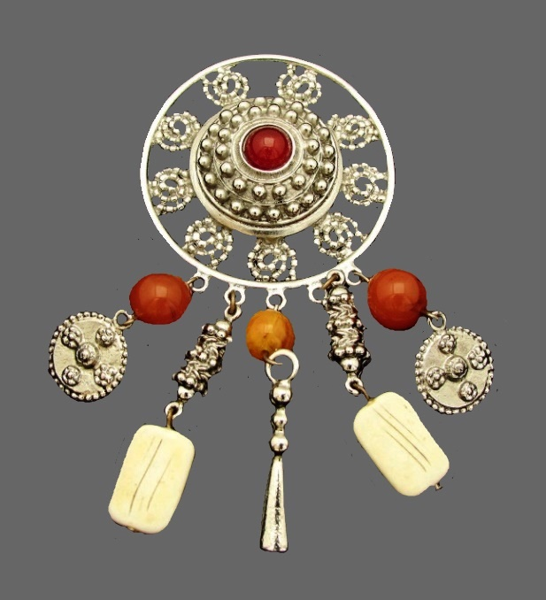 Large brooch with charms, 1980s. Jewelery mesh, silver tone charms, pressed amber