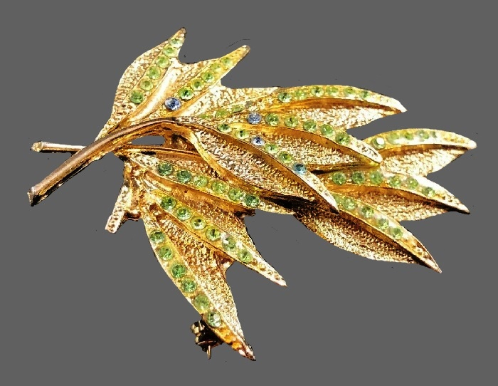Leaf brooch. Gold tone textured metal, green and blue rhinestones