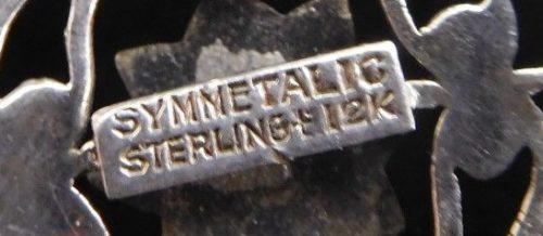 Marked Symmetalic