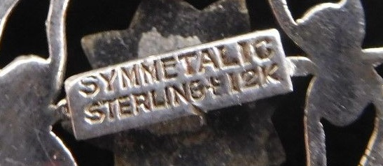 Marked Symmetalic