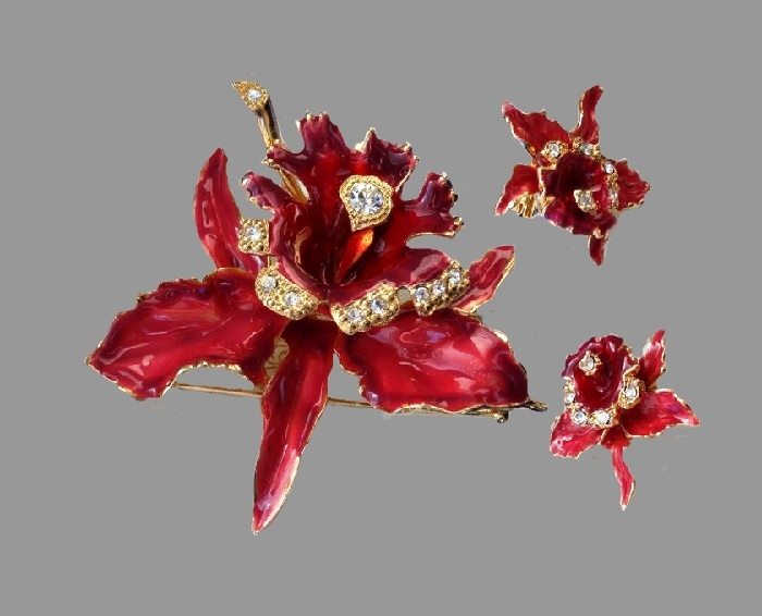 Orchids clip and brooch. It is made of jewelery alloy for gold, richly decorated with colored enamels and decorated with crystals