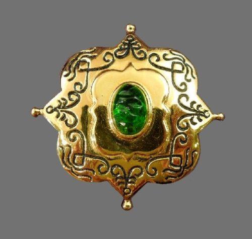 Oriental motif gold tone green glass brooch