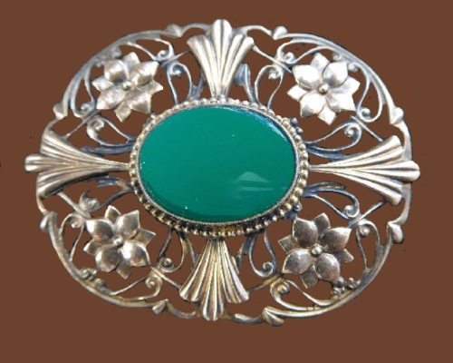 Oval floral design brooch. Sterling silver, 12K gold plated, green agate