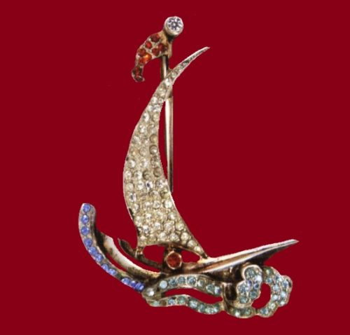 Sailboat. 1947. Gold-plated sterling brooch with blue, white and red rhinestones