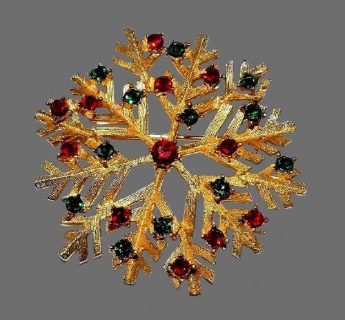 Snowflake brooch. Gold tone textured metal, rhinestones