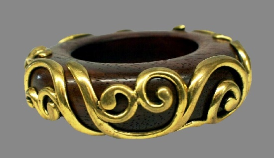 Teak wooden bangle bracelet decorated with gold tone patterns