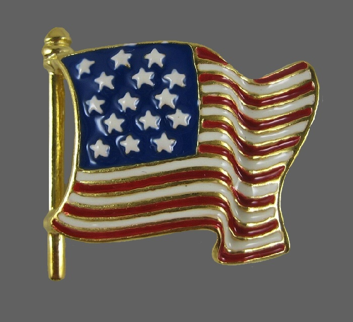 US flag. Gold tone jewelry alloy, enamel