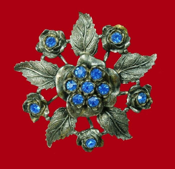 Viola flower brooch. Silver tone textured metal, blue rhinestones
