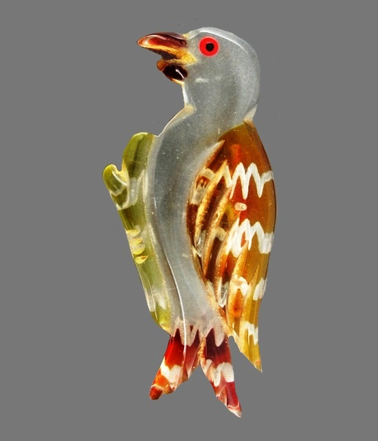Bird brooch of lucite