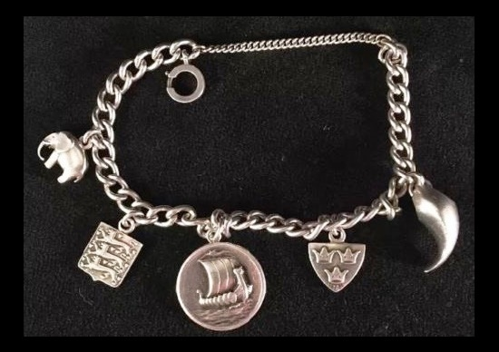 Circa mid-20th century, Denmark sterling silver bracelet with charms