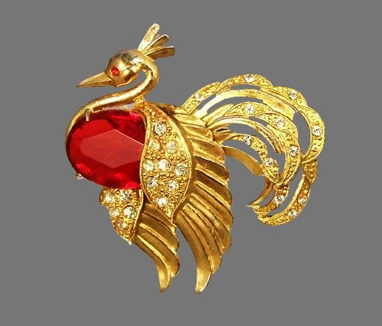 Firebird gold tone brooch. Red glass cabochon, rhinestones