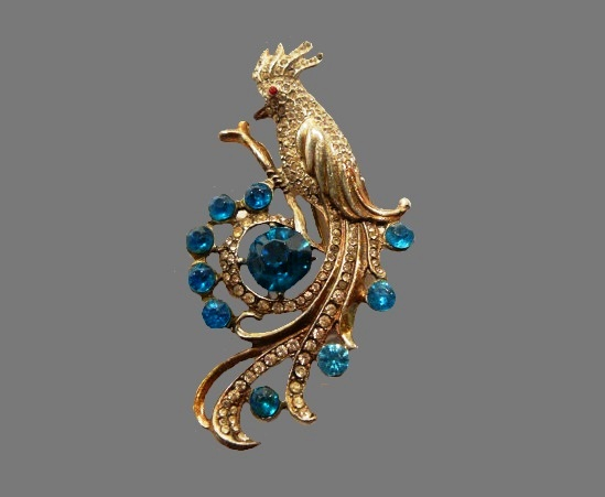 Peacock brooch. Jewelry alloy, rhinestones, glass cabochon