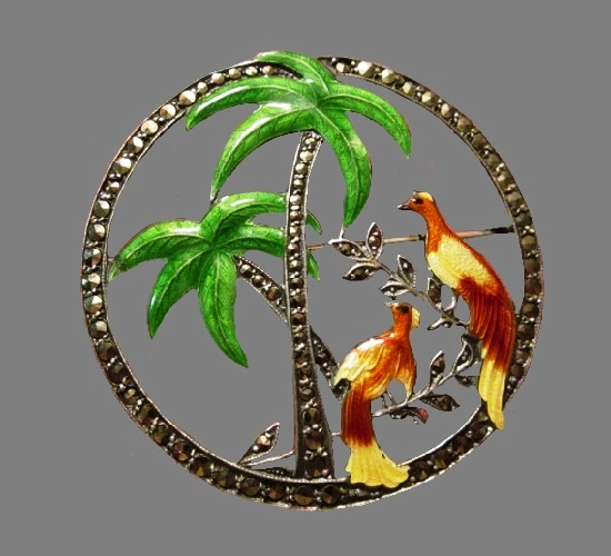 Round shaped enameled brooch with palm trees and bird design