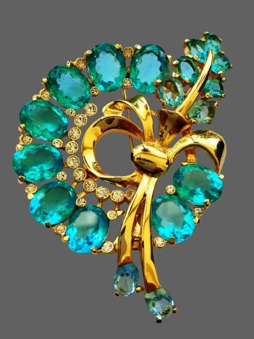 Gorgeous blue glass floral design brooch. Gold tone metal, clear crystals