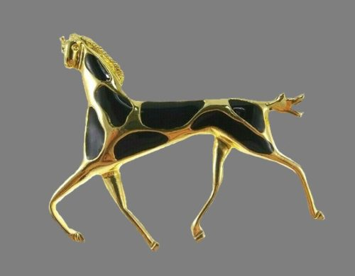 Horse brooch. Gold tone, black enamel