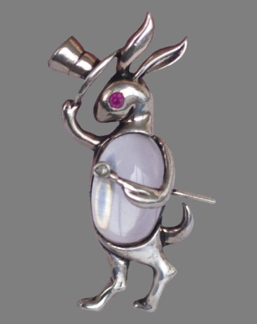 Rabbit taking off its hat and holding a cane brooch. Gold plated sterling silver, lucite, red cabochon, rhinestones. 1944. 5.5 cm