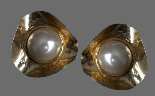 Triangular shaped gold tone with faux pearl in the center earrings