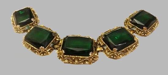 Rare vintage bracelet of gold tone with green glass inserts