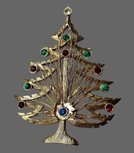 Christmas tree vintage brooch. Gold tone metal, wire, red and green rhinestones