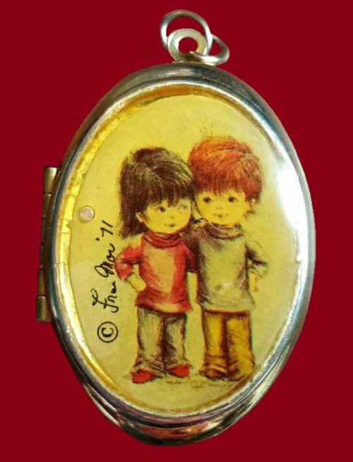 A Locket. Opens to hold a little keepsake or two photos. 1971