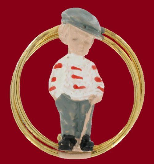 A boy in a striped shirt pin