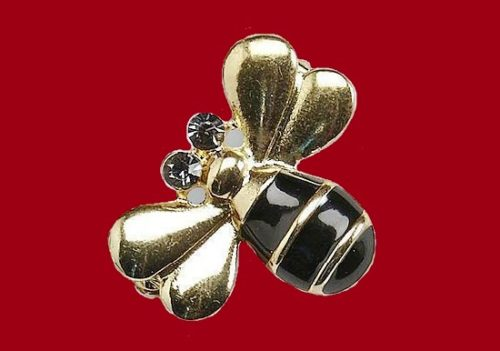 Bee pin of gold tone. Decorated with black enamel, beads and rhinestones