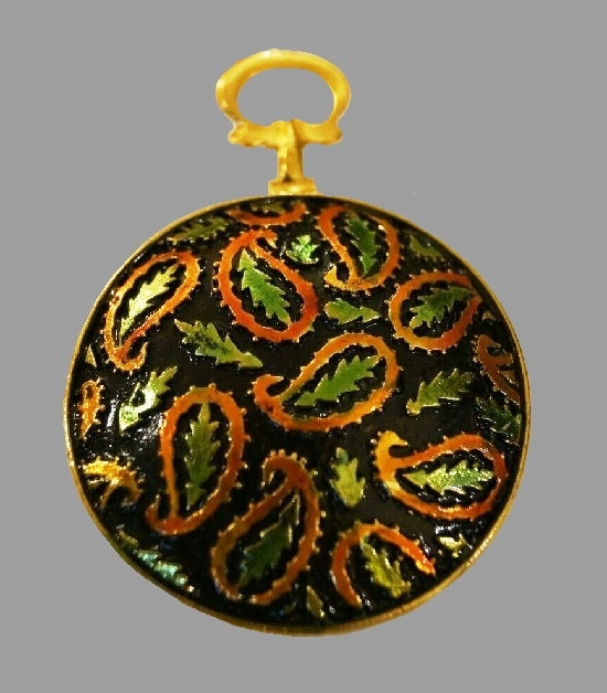 Black enamel gold tone round brooch. Green orange paisley leaves