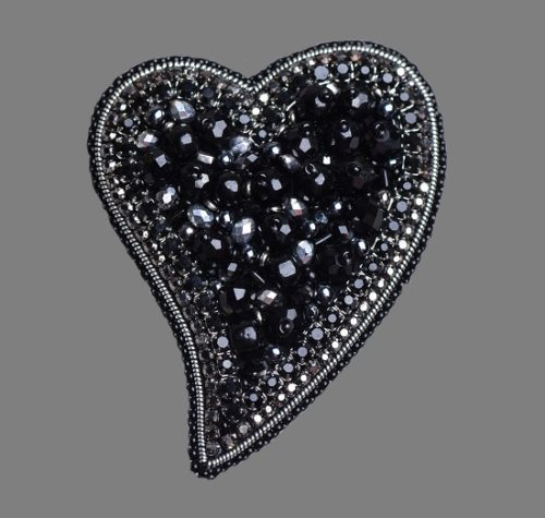 Black heart brooch from the collection 'Love is...'. Czech beads, faceted beads, swarovski crystals, Japanese beads, crystal ribbon, strass chain. 7cm