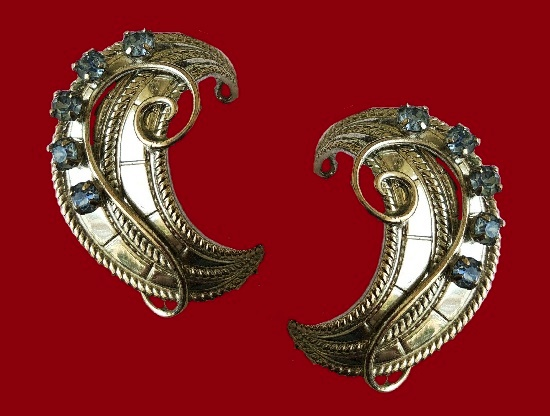 Crescent shaped earrings. Jewelry alloy, blue rhinestones