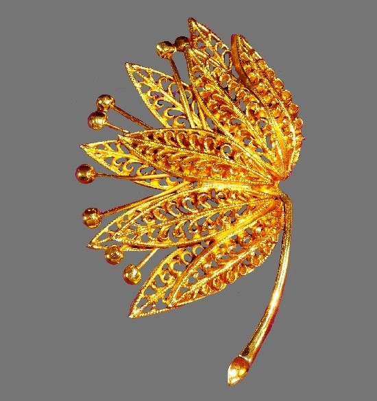 Filigree leaf floral design. Gold tone metal