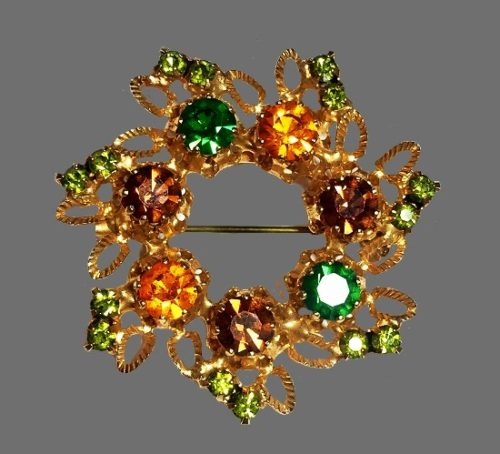 Flower design wreath pin. Gold tone metal, multicolor crystals