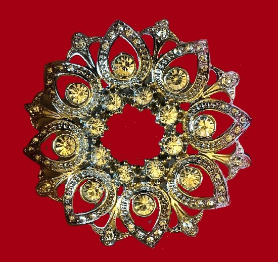 Ornamental brooch. Yellow rhinestones, clear crystals, silver tone metal