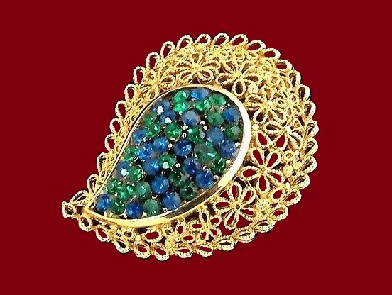 Paisley shaped gold tone brooch. Green and blue crystal rhinestones