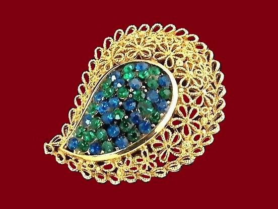 Paisley shaped gold tone brooch. Green and blue crystal rhinestones