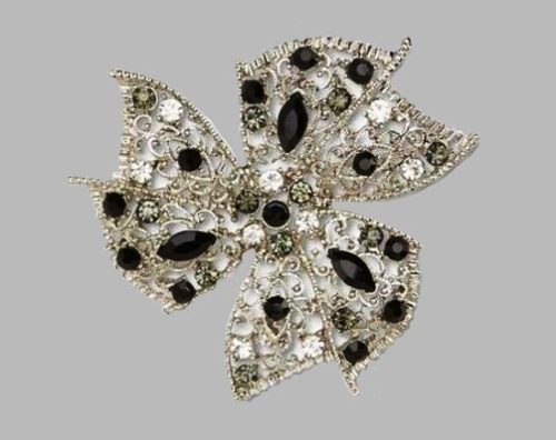 Pinwheel silver tone filigree brooch with clear crystals, multicolor rhinestones and black beads