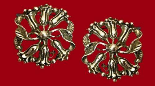 Silver tone metal floral wreath pinwheel clip on earrings