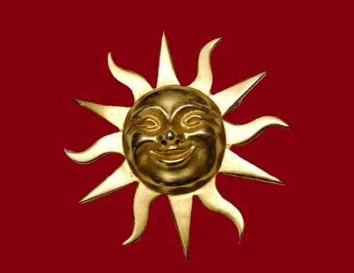 Smiling Sun gold tone pendant