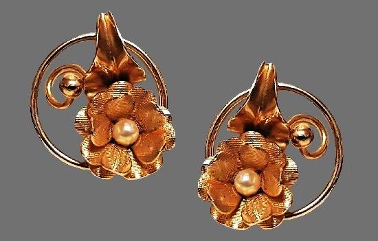 Textured gold tone metal flower clip earrings