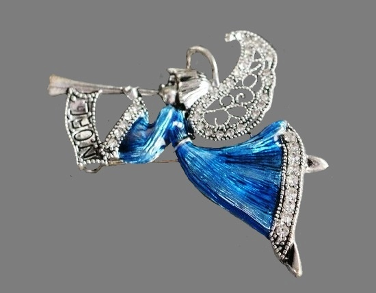 Trumpeting Angel Noel brooch pin of silver tone, enamel