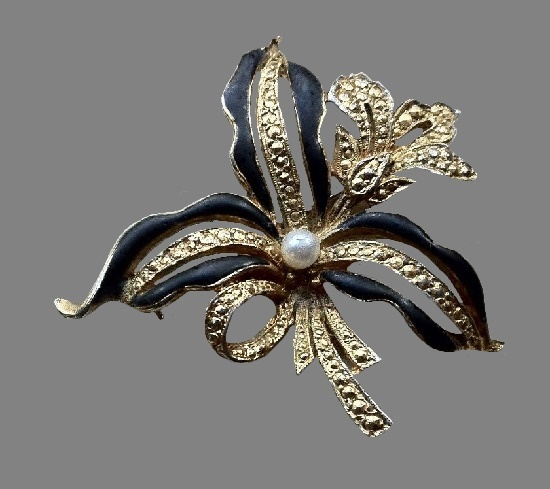 Black enamel silver tone flower brooch