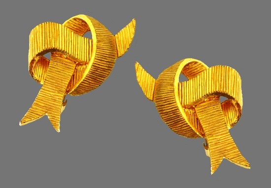 Bowtie clip on earrings. Gold tone textured metal