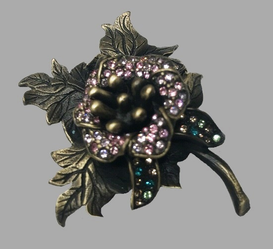 Floral leaf wreath brooch. Bronze tone metal, with pink, blue, green and brown rhinestones