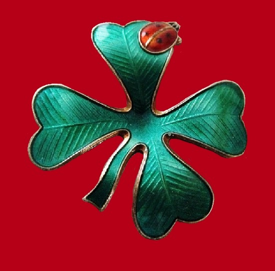 Four-leaf Clever with a lady-bug brooch. Sterling silver, enamel